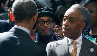 President Barack Obama greets film director, producer, writer and actor Spike Lee, left,  and the Rev. Al Sharpton, Friday, April 11, 2014, at the National Action Network conference, in New York. (AP Photo/Newsday, Craig Ruttle, Pool)
