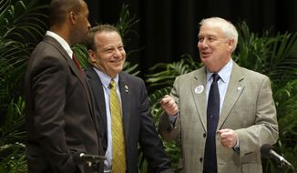 Candidates Charles Lollar, from left, Ron George and David Craig chat before participating in a debate for Republican gubernatorial candidates at Johns Hopkins University in Baltimore, Thursday, April 10, 2014. The candidates are competing for a chance to succeed Democratic Gov. Martin O'Malley, who is unable to run for re-election due to term limits. (AP Photo/Patrick Semansky)