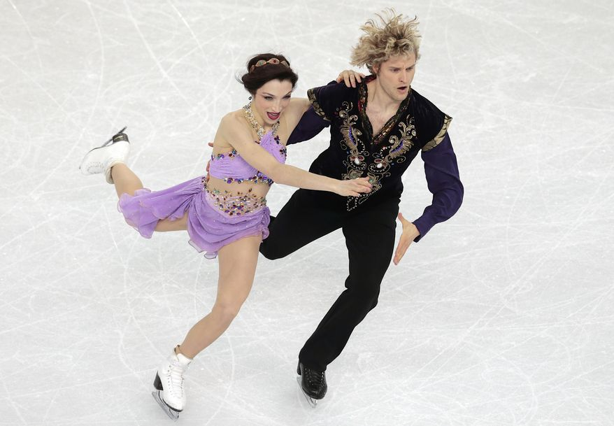 FILE - In this Feb. 17, 2014, file photo, Meryl Davis and Charlie White compete in the ice dance free dance figure skating finals at the Iceberg Skating Palace during the 2014 Winter Olympics in Sochi, Russia. After years of hard work and outstanding performances culminated in an Olympic gold medal Davis and White would seem to deserve down time. Instead, and by choice, the ice dance champions are busier than ever. (AP Photo/Ivan Sekretarev, File)