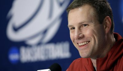 """FILE - In this March 22, 2014 file photo, Iowa State coach Fred Hoiberg smiles as he answers a question during an NCAA college basketball tournament news conference in San Antonio. Iowa State has given Hoiberg a $600,000 a year raise, bumping his average annual salary to $2.6 million in an effort to keep """"The Mayor"""" in Ames for life. The Cyclones announced a revised contract for Hoiberg on Friday, April 11, 2014. (AP Photo/David J. Phillip, File)"""