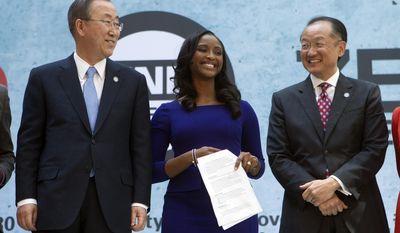 From left, UN Secretary General Ban Ki-moon, CNN International anchor Isha Sesay, and World Bank President Jim Yong Kim attend the forum Endpoverty 2030 during the IMF/World Bank Spring Meetings at IMF headquarters in Washington, Thursday, April 10, 2014. ( AP Photo/Jose Luis Magana)