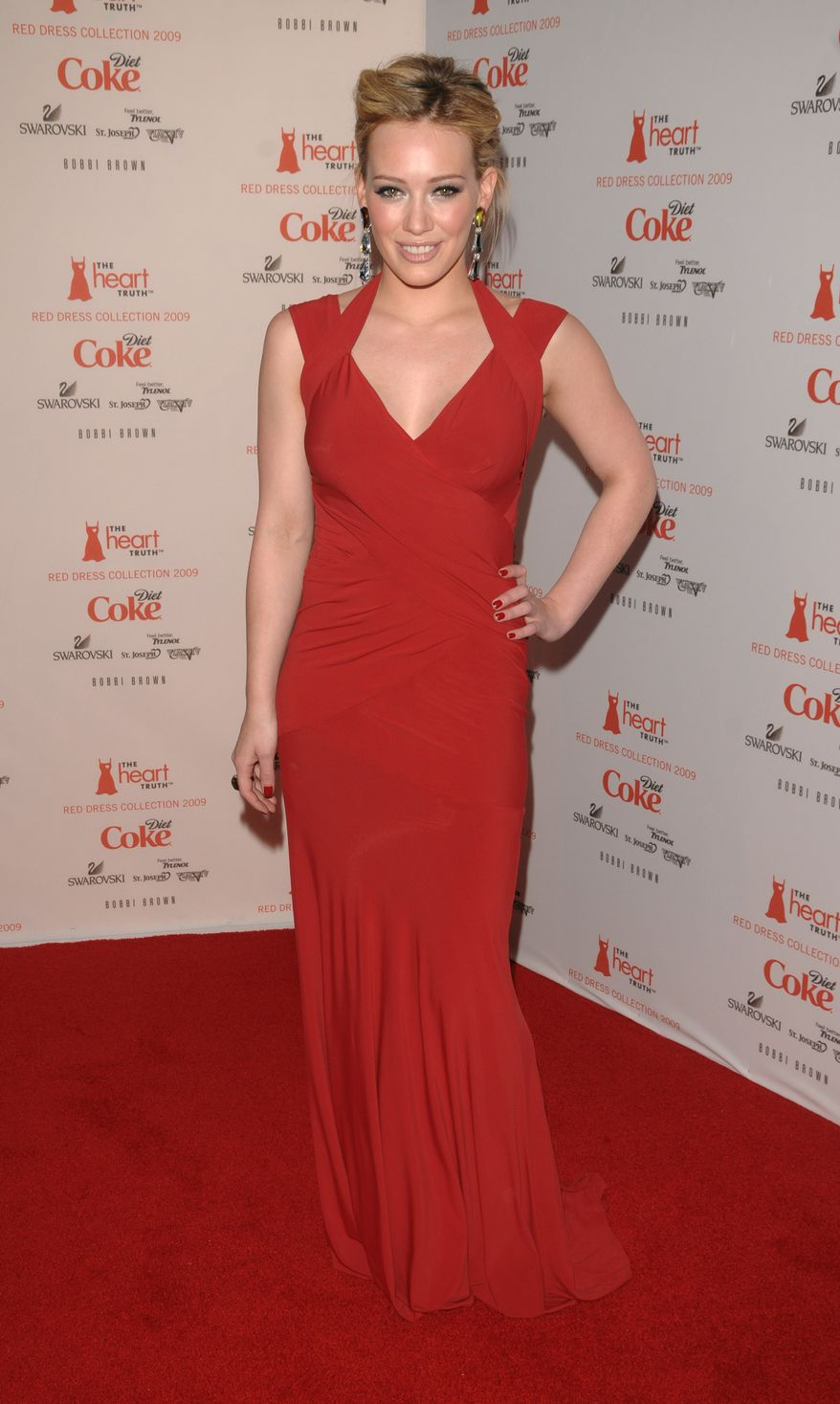 Actress Hilary Duff arrives to the Heart Truth's Red Dress collection during Fashion Week in New York on Friday, Feb. 13, 2009.  (AP Photo/Peter Kramer) ** FILE **