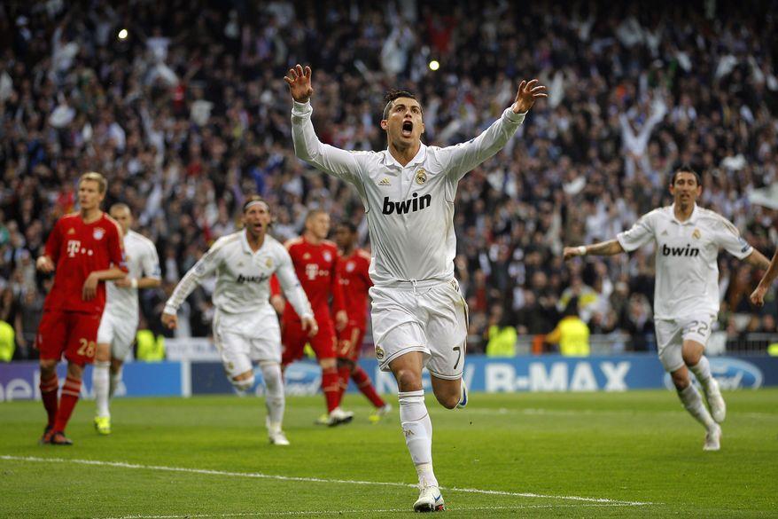 Real Madrid's Cristiano Ronaldo from Portugal celebrates after scoring during a semi final second leg Champions League soccer match against Bayern Munich at the Santiago Bernabeu stadium, in Madrid, Wednesday, April 25, 2012. (AP Photo/Daniel Ochoa de Olza)