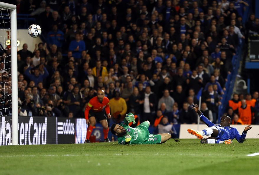 Chelsea's Demba Ba scores his side's 2nd goal during the Champions League second leg quarterfinal soccer match between Chelsea and Paris Saint-Germain at Stamford Bridge Stadium  in London, Tuesday, April 8, 2014. (AP Photo/Kirsty Wigglesworth)