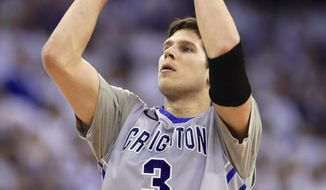 In this March 8, 2014, photo, Creighton's Doug McDermott shoots against Providence during an NCAA college basketball game in Omaha, Neb. McDermott accepted the John R. Wooden Award on Friday night, April 11, 2014, one of several honors the senior won this year as college basketball's player of the year. The women's award went to Chiney Ogwumike of Stanford in a ceremony at the Los Angeles Athletic Club. (AP Photo/Nati Harnik)