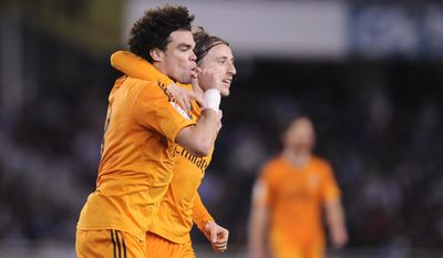 Real Madrid's Pepe of Portugal, left, celebrates his goal and the third of his team with Luka Modric of Croatia, after scoring against Real Sociedad, during their Spanish League soccer match, at Anoeta stadium, in San Sebastian, Spain, Saturday, April 5, 2014. (AP Photo/Alvaro Barrientos)
