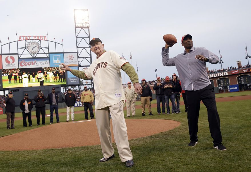 Former San Francisco Giants manager Roger Craig, left, and Former San Francisco 49ers' Keena Turner throw out ceremonial first pitches before a baseball game between the Giants and the Arizona Diamondbacks, Thursday, April 10, 2014, in San Francisco. (AP Photo/Marcio Jose Sanchez)