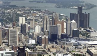 In this July 16, 2013 aerial file photo, the downtown of the city of Detroit is shown. Federal Judge Steven Rhodes approved bankrupt Detroit's plan to settle a bad multi-million dollar pension debt deal with two banks on Friday, April 11, 2014. Rhodes signed off on the agreement to pay $85 million to UBS and Bank of America. (AP Photo/Paul Sancya)