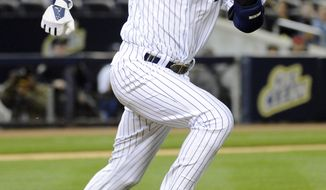 New York Yankees' Derek Jeter beats out a throw for an infield single during the third inning of a baseball game against the Boston Red Sox Friday, April 11, 2014, at Yankee Stadium in New York. (AP Photo/Bill Kostroun)