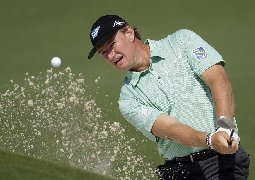 Ernie Els, of South Africa, chips out of a bunker on the second hole during the second round of the Masters golf tournament Friday, April 11, 2014, in Augusta, Ga. (AP Photo/Chris Carlson)