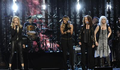 Sheryl Crow, Carrie Underwood, Bonnie Raitt, Emmylou Harris, and Glenn Frey perform at the 2014 Rock and Roll Hall of Fame Induction Ceremony on Thursday, April, 10, 2014 in New York. (Photo by Charles Sykes/Invision/AP)