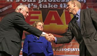 RETRANSMISSION TO REMOVE EXTRANEOUS CROPPING ARTIFACT AT LOWER LEFT - Illinois Gov. Pat Quinn, left, and his Republican rival, Bruce Rauner, shake hands after they appeared together for the first time before the 2014 general election, during the annual meeting of the Illinois Education Association Friday, April 11, 2014, in Chicago. IEA president Cinda Klickna, who moderated the event, stands between them. (AP Photo/M. Spencer Green)