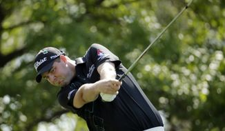 Marc Leishman, of Australia, tees off on the fourth hole during the second round of the Masters golf tournament Friday, April 11, 2014, in Augusta, Ga. (AP Photo/Charlie Riedel)