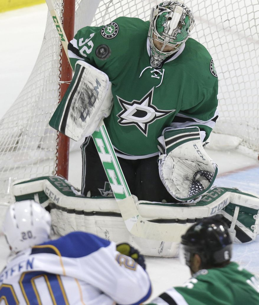 Dallas Stars goalie Kari Lehtonen blocks a shot by St. Louis Blues left wing Alexander Steen (20) during the first period of an NHL hockey game Friday, April 11, 2014, in Dallas. Lehtonen recorded his fifth shutout of the season in the 3-0 Stars win. (AP Photo/LM Otero)