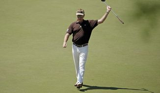 Miguel Angel Jimenez, of Spain, celebrates his fist after a birdie on the 16th hole during the third round of the Masters golf tournament Saturday, April 12, 2014, in Augusta, Ga. (AP Photo/Charlie Riedel)