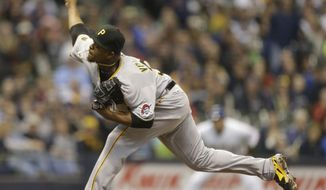 Pittsburgh Pirates starting pitcher Edinson Volquez throws against the Milwaukee Brewers during the first inning of a baseball game Saturday, April 12, 2014, in Milwaukee. (AP Photo/Jeffrey Phelps)