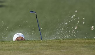 Jordan Spieth chips out of a bunker on the seventh hole during the third round of the Masters golf tournament Saturday, April 12, 2014, in Augusta, Ga. (AP Photo/David J. Phillip)