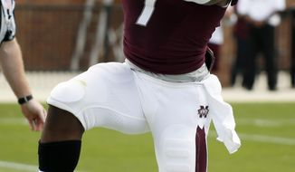 CORRECTS YEAR - Mississippi State's Maroon running back Nick Griffin (7) leaps for joy after scoring a touchdown against the White squad during the first half of their spring NCAA college football game, Saturday, April 12, 2014, in Starkville, Miss. Maroon won 41-38. (AP Photo/Rogelio V. Solis)