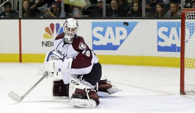 Colorado Avalanche goalie Reto Berra, of Switzerland, is beaten for a goal  on a shot from San Jose Sharks' Patrick Marleau during the first period of an NHL hockey game on Friday, April 11, 2014, in San Jose, Calif. (AP Photo/Marcio Jose Sanchez)