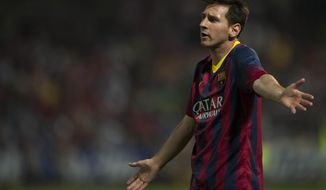 Barcelona's Lionel Messi from Argentina gestures during a Spanish La Liga soccer match between FC Granada and FC Barcelona at Los Carmenes stadium in Granada, Spain, Saturday, April 12, 2014. (AP Photo/Daniel Tejedor)