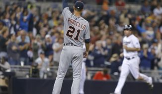 Detroit Tigers starting pitcher Rick Porcello watches San Diego Padres' Seth Smith head home on Chase Headley's home run off Porcello in the sixth inning of a baseball game Friday, April 11, 2014, in San Diego. (AP Photo/Lenny Ignelzi)