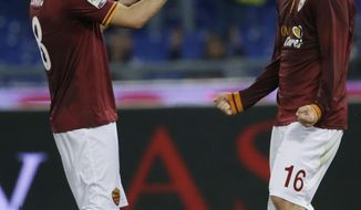 Roma's Adem Liajic, left, celebrates with teammate Daniele De Rossi after scoring during a Serie A soccer match between Roma and Atalanta at Rome's Olympic stadium, Saturday, April 12, 2014. (AP Photo/Gregorio Borgia)