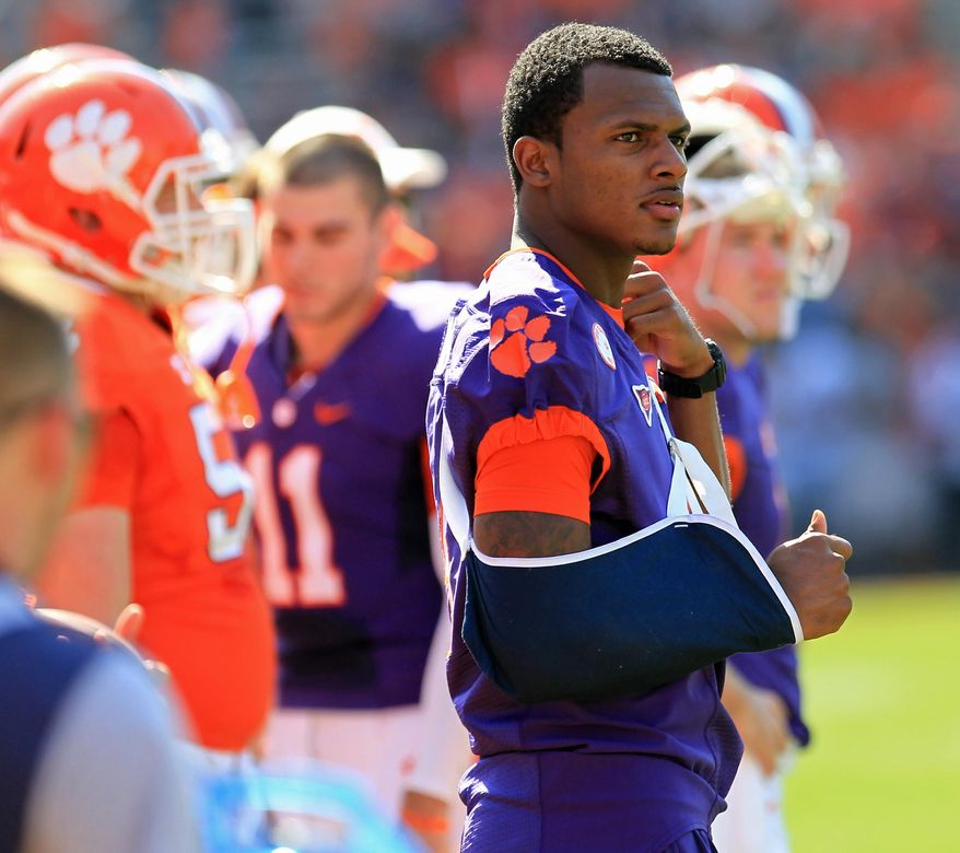 Clemson freshman quarterback Deshuan Watson, with his arm in a sling, watches the NCAA college football team's spring game Saturday, April 12, 2014, in Clemson, S.C. (AP Photo/Anderson Independent-Mail, Mark Crammer) SENECA JOURNAL OUT  GREENVILLE NEWS OUT
