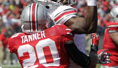 Ohio State wide receiver Michael Thomas, top, loses control of the ball as safety Ron Tanner defends during a spring NCAA college football game Saturday, April 12, 2014, in Columbus, Ohio. (AP Photo/Jay LaPrete)