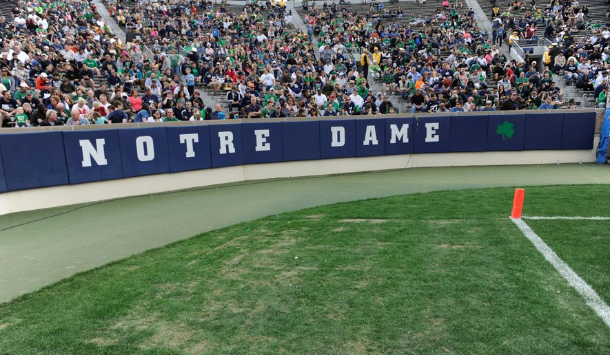 Fans fill a corner of Notre Dame Stadium during the second half Notre Dame's spring NCAA college football game Saturday April 12, 2014 in South Bend, Ind. The Blue Gold game marks the end of spring football practice. Artificial turf will be installed at the stadium in time for the start of the upcoming football season, athletic director Jack Swarbrick said. (AP Photo/Joe Raymond)