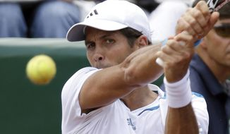 Fernando Verdasco of Spain returns a shot to Santiago Giraldo of Colombia in a semifinal match at the U.S. Men's Clay Court Championship, Saturday, April 12, 2014, in Houston. Verdasco won 6-4, 7-5. (AP Photo/Pat Sullivan)
