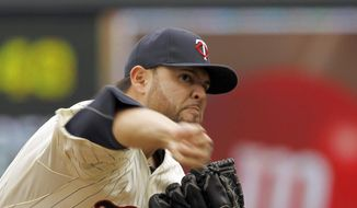 Minnesota Twins starting pitcher Ricky Nolasco delivers to the Kansas City Royals during the first inning of a baseball game in Minneapolis, Saturday, April 12, 2014. (AP Photo/Ann Heisenfelt)