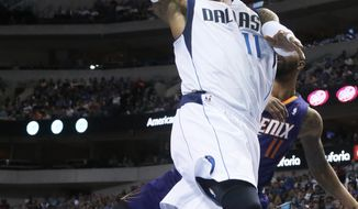 Dallas Mavericks' Monta Ellis, front, drives the lane as Phoenix Suns' Markieff Morris defends in the first quarter of an NBA basketball game in Dallas, Saturday, April 12, 2014. (AP Photo/Dallas Morning News, Louis DeLuca) MANDATORY CREDIT; NO SALES; MAGAZINES OUT; TV OUT; INTERNET USE BY AP MEMBERS ONLY