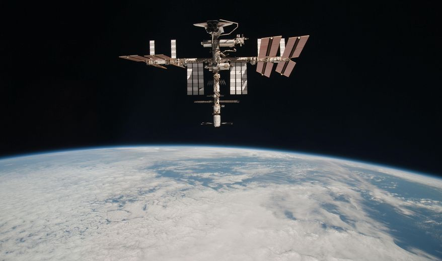 FILE - This May 23, 2011 photo released by NASA shows the International Space Station at an altitude of approximately 220 miles above the Earth, taken by Expedition 27 crew member Paolo Nespoli from the Soyuz TMA-20 following its undocking. A computer outage at the International Space Station may require a spacewalk by astronauts and threatens to delay next week's launch of a commercial supply ship for NASA. NASA said Friday night April 11, 2014 that a backup computer on the outside of the orbiting lab is not responding to commands. (AP Photo/NASA, Paolo Nespoli)
