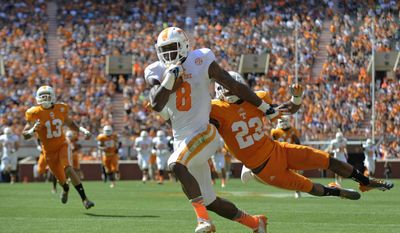 Tennessee wide receiver Marquez North (8) runs for a touchdown past Tennessee defensive back Cameron Sutton (23) during the first half of the Orange and White spring NCAA college football game at Neyland Stadium in Knoxville, Tenn., Saturday, April 12, 2014. (AP Photo/Knoxville News Sentinel, Adam Lau)