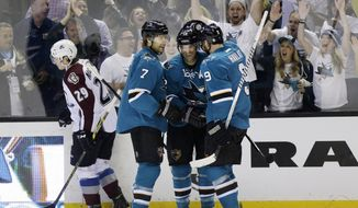 San Jose Sharks' Patrick Marleau, center, celebrates his goal with teammates Brad Stuart (7), and Martin Havlat (9), of the Czech Republic, during the first period of an NHL hockey game against the Colorado Avalanche on Friday, April 11, 2014, in San Jose, Calif. (AP Photo/Marcio Jose Sanchez)