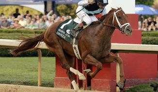 Danza and Jockey Joe Bravo (1) cross the finish line to win the Arkansas Derby horse race at Oaklawn Park in Hot Springs, Ark., Saturday, April 12, 2014. (AP Photo/Danny Johnston)
