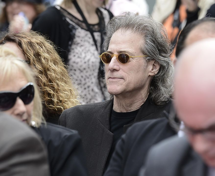Actor and comedian Richard Lewis looks on as actor and comedian Jerry Lewis is honored with a hand and footprint ceremony at TCL Chinese Theatre on Saturday, April 12, 2014 in Los Angeles. (Photo by Dan Steinberg/Invision/AP Images)