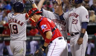 Houston Astros Robbie Grossman is congratulated on his fourth inning homer, scoring Chris Carter 23) and Matt Dominguez (30) in the fourth inning at Globe Life Park in Arlington, Texas on Saturday, April 12, 2014. (AP Photo/The Dallas Morning News, Tom Fox) MANDATORY CREDIT, NO SALES, MAGS OUT, TV OUT