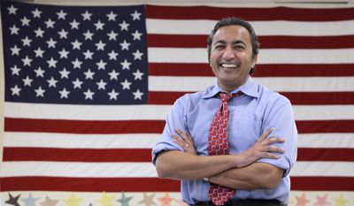 FILE - In this Oct. 26, 2012, file photo, Rep. Ami Bera is seen at his campaign office in Elk Grove, Calif., before winning his election that unseated incumbent Republican Dan Lungren. Bera, a first-term Democrat in a Sacramento-area seat, is a physician who favors expanding access to health care. Yet he has been voting with the Republican majority in the House to amend or overturn parts of the federal Affordable Care Act. Bera is one of a handful of Democrats in California who represent congressional districts that are closely divided between Democrats and Republicans, after voters approved an independent redistricting process. (AP Photo/Rich Pedroncelli, File)