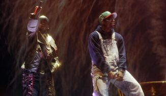 Big Boi, left, and Andre 3000 of Outkast perform behind a screen during their headlining set on the first day of the 2014 Coachella Music and Arts Festival on Friday, April 11, 2014, in Indio, Calif. (Photo by Chris Pizzello/Invision/AP)