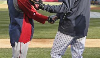 New York Yankees shortstop Derek Jeter, right, greets Boston Red Sox second baseman Dustin Pedroia before a baseball game at Yankee Stadium in New York, Thursday, April 10, 2014.  (AP Photo/Kathy Willens)