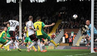 Fulham's Hugo Rodallega, left no. 20, scores against Norwich City during their English Premier League soccer match at Craven Cottage, London, Saturday April 12, 2014. (AP Photo/PA, Nigel French) UNITED KINGDOM OUT  NO SALES  NO ARCHIVE