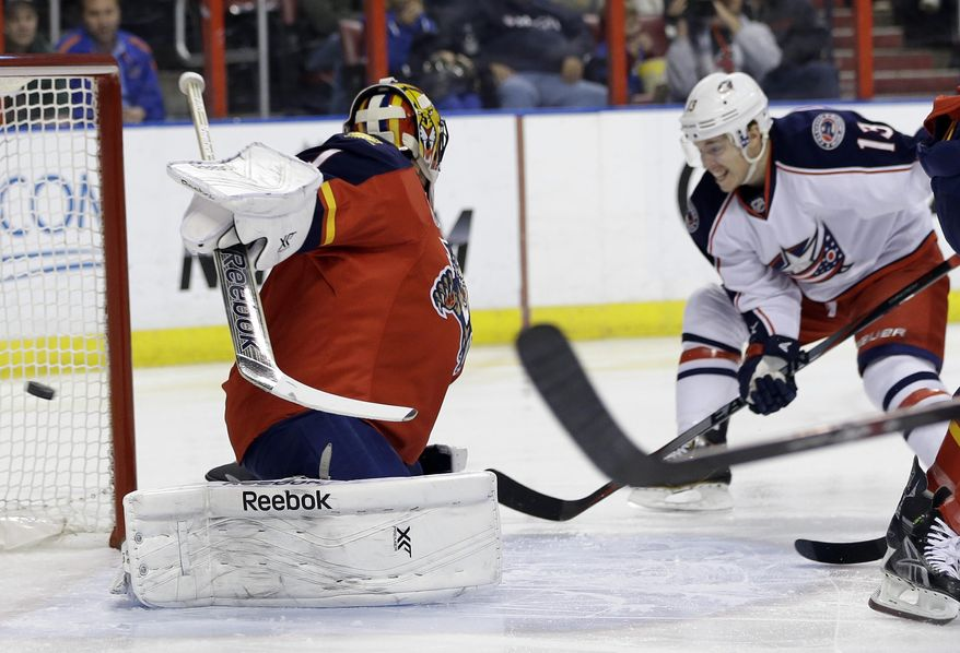 Columbus Blue Jackets' Cam Atkinson (13) scores a goal as the puck gets past Florida Panthers goalie Roberto Luongo in the first period of a hockey game, Saturday, April 12, 2014, in Sunrise, Fla. (AP Photo/Lynne Sladky)
