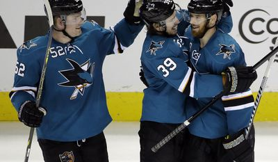 San Jose Sharks' Martin Havlat, right, of the Czech Republic, celebrates his third goal of the game against the Colorado Avalanche with teammates Logan Couture (39) and Matt Irwin (52) during the third period of an NHL hockey game on Friday, April 11, 2014, in San Jose, Calif. San Jose won 5-1.(AP Photo/Marcio Jose Sanchez)