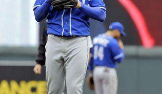 Kansas City Royals pitcher James Shields reacts after walking Minnesota Twins' Aaron Hicks with the bases loaded during the second inning of a baseball game in Minneapolis, Saturday, April 12, 2014. The Twins won 7-1.(AP Photo/Ann Heisenfelt)