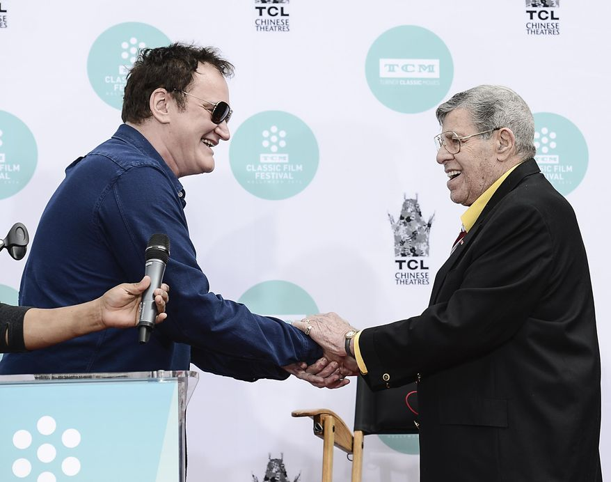 Director Quentin Tarantino shakes hands with actor and comedian Jerry Lewis as Lewis is honored with a hand and footprint ceremony at TCL Chinese Theatre on Saturday, April 12, 2014 in Los Angeles. (Photo by Dan Steinberg/Invision/AP Images)