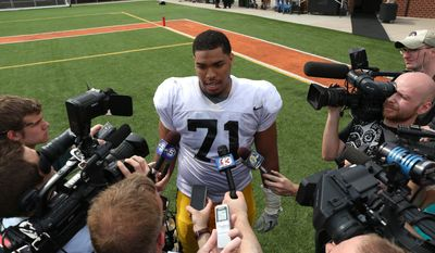 Iowa defensive lineman Carl Davis speaks to reporters at the NCAA college football team's practice Saturday, April 12, 2014, at Valley High Stadium in West Des Moines, Iowa. (AP Photo/The Des Moines Register, Bryon Houlgrave) MAGS OUT  NO SALES   TV OUT  MANDATORY CREDIT