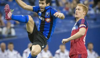 Montreal Impact's Felipe Martins, left, jumps for the header stealing the ball from Chicago Fire's Jeff Larentowicz during the first half of an MLS soccer game in Montreal, Saturday, April 12, 2014. (AP Photo/The Canadian Press, Peter McCabe)