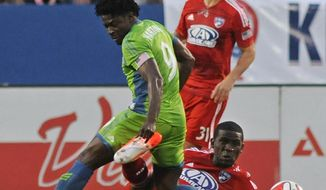 Seattle Sounders' Obafemi Martins (9) steps on FC Dallas' Hendry Thomas (20) during an MLS soccer game Saturday, April 12, 2014, in Frisco, Texas. The Sounders won 3-2. (AP Photo/The Dallas Morning News, Mark M. Hancock) MANDATORY CREDIT, NO SALES, MAGS OUT, TV OUT, INTERNET USE BY AP MEMBERS ONLY