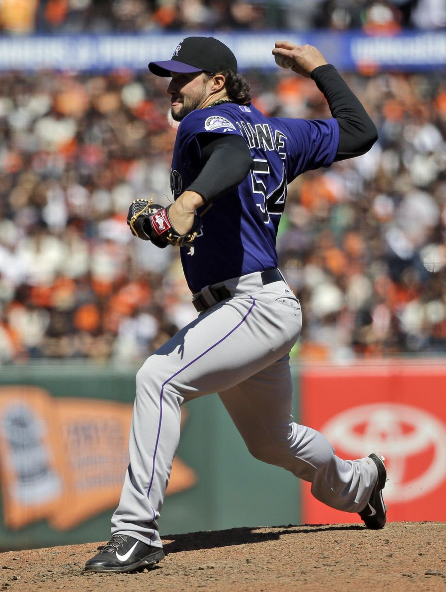 Colorado Rockies relief pitcher Tommy Kahnle throws to the San Francisco Giants during a baseball game on Saturday, April 12, 2014, in San Francisco. Colorado won 1-0. (AP Photo/Marcio Jose Sanchez)
